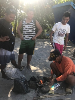 Locals helping us start a fire